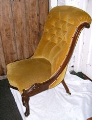 A Victorian Mahogany slipper chair, this chair has very good carving and is upholstered in gold velvet.