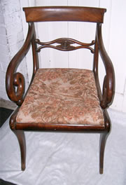 A very good Regency mahogany carver chair with nice cross rail scroll arms drop in seat and sabre front legs