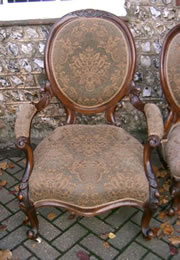 A very nice pair of matching ladies and gentlemans walnut spoonback chairs
