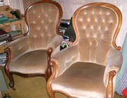 A very near matching pair of Victorian mahogany showood armchairs