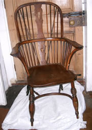 A very early Windsor chair c1780/1800 in yew and elm