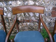 A Will IV Mahogany carver with scroll arms stuffover seat and well carved back in excellent condition