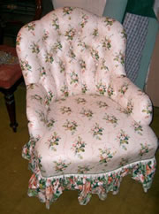 A late Victorian buttoned back tub chair