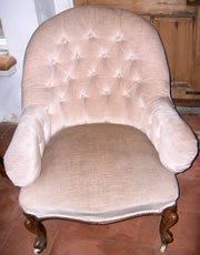 A very nice Victorian buttoned back chair with mahogany cabriole legs