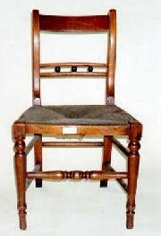 A Country chair in Fruitwood, early C19.