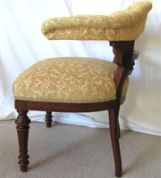 A magnificent large solid oak bowed back chair