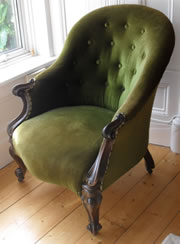 An Elegant Rosewood Victorian Armchair with Button Back c1860